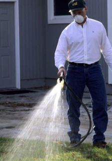 Man Washing Chemicals from Lawn