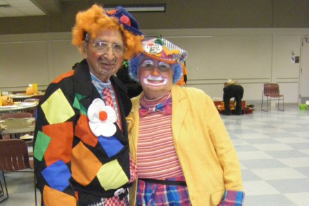 A couple of seniors dressed up as clowns for halloween