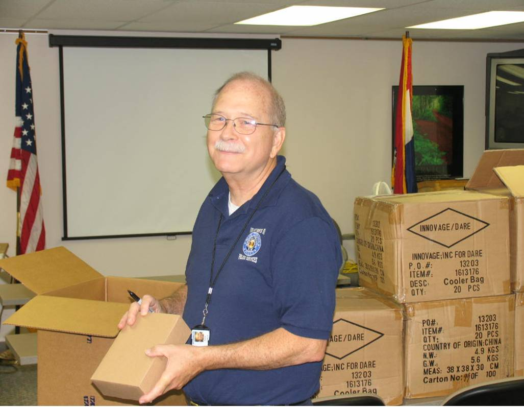 Rick Lynch volunteers to assist Officer Waites with inventory of items for the DARE Program